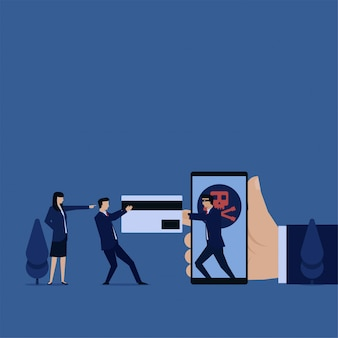 Hacker de negocios arrebatar la tarjeta de crédito de la metáfora del teléfono de piratería.