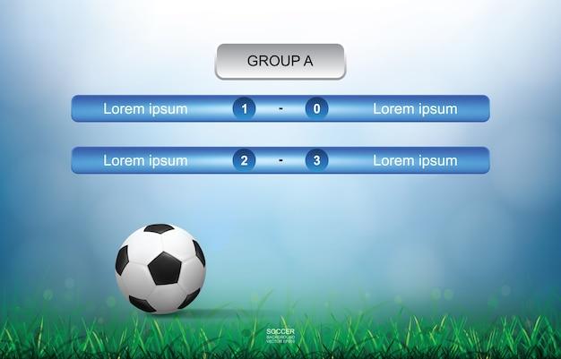 Haga juego el fondo del horario de la taza del fútbol del fútbol con la luz empañó el fondo del bokeh.