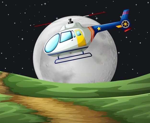 Helicóptero volando en la noche de luna llena