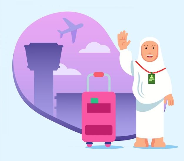 Hembra en el aeropuerto lista para el viaje de pilgimage a la meca.