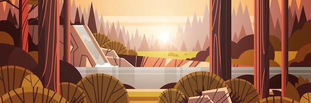 Hermosa cascada sobre acantilado rocoso amarillo otoño bosque naturaleza paisaje