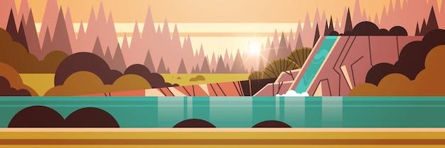 Hermosa cascada sobre acantilado rocoso otoño bosque puesta de sol paisaje