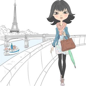 Hermosa chica en una bufanda con un paraguas