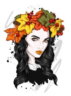 Hermosa chica con cabello largo en una corona de hojas de otoño.