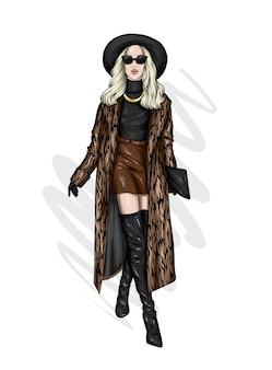 Hermosa chica con un elegante abrigo y sombrero.