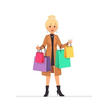 Hermosa chica rubia con bolsas de dibujos animados personaje de dibujos animados