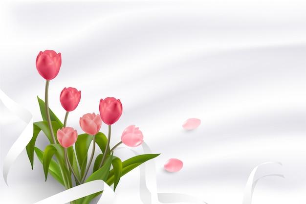 Hermosa flor de tulipanes rojos y rosados realistas colocados sobre fondo pastel suave.
