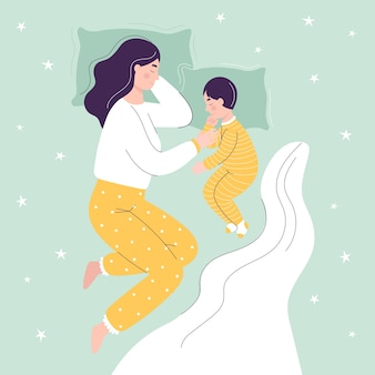 Hermosa madre e hijo están durmiendo en la cama