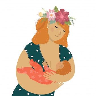 Una hermosa madre con flores en el pelo amamantando a su bebé niño.