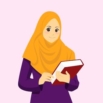 Una hermosa mujer musulmana con un hijab sosteniendo un libro
