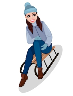 Hermosa mujer sentada en trineo