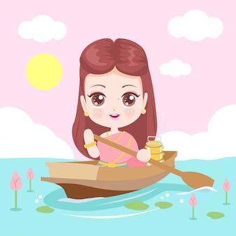 Hermosa mujer tailandesa remando en un canal
