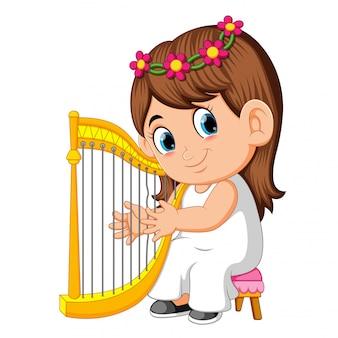 Una hermosa niña con el pelo largo y castaño tocando el arpa.