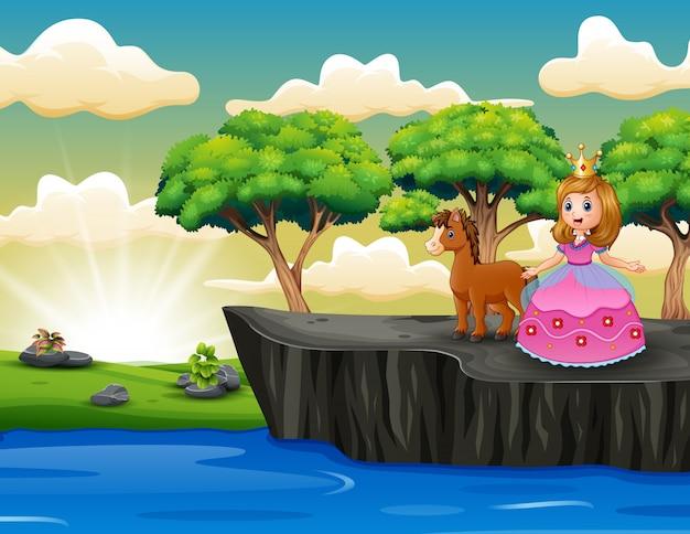 Hermosa princesa con un caballo de pie en el acantilado
