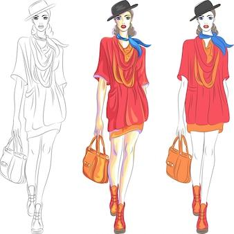 Hermosa top model de chica de moda con sombrero y bolsa