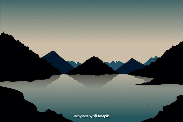 Hermosa vista con paisaje de montañas y lago