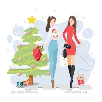 Hermosas amigas invierno compras navideñas junto con su cachorro bulldog francés aislado