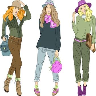 Hermosas chicas de moda top models en sombreros y pantalones