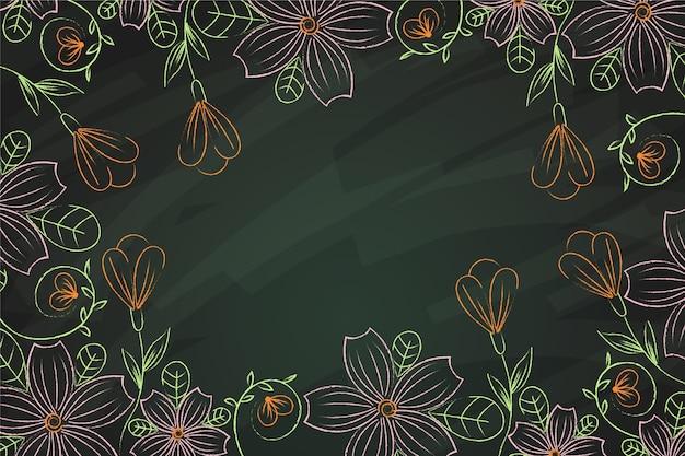 Hermosas flores dibujadas a mano sobre fondo de pizarra