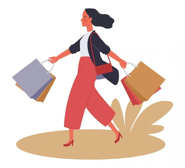 Hermosas mujeres de compras. chica con bolsa de compras.