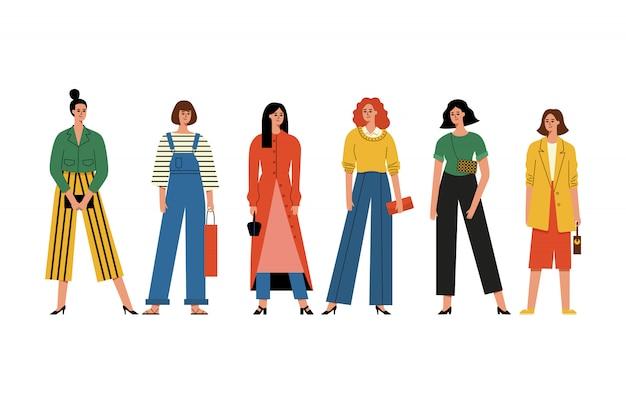Hermosas mujeres o niñas de pie juntos.