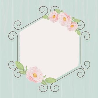 Hermosas rosas rosadas inglesas en marco de corona de arco de hiedra hexagonal sobre fondo de textura de madera azul grunge
