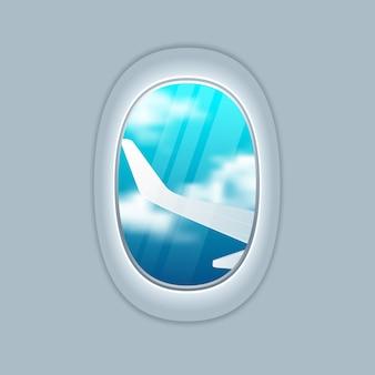 Hermoso amanecer a través de la ventana del avión