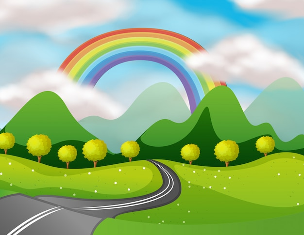 Hermoso camino de naturaleza bajo el arco iris