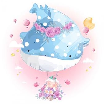 Hermoso globo de ballena con columpios divertidos de ovejas.