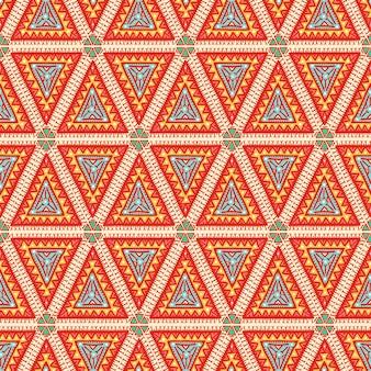Hermoso patrón transparente de color tribal gráfico con triángulos naranjas