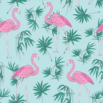 Hermoso patrón transparente tropical con pájaros flamencos rosados y follaje de palma de selva verde dibujado a mano sobre fondo azul.