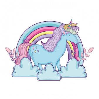 Hermoso pequeño unicornio en las nubes y el arco iris