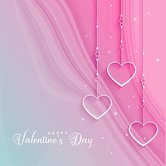 Hermoso saludo del día de san valentín con corazones colgantes