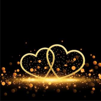 Hermosos corazones dorados sobre fondo de destellos