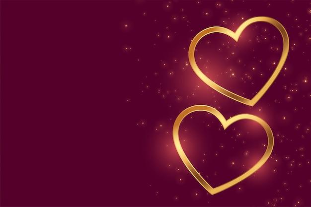 Hermosos dos corazones de amor dorado con espacio de texto