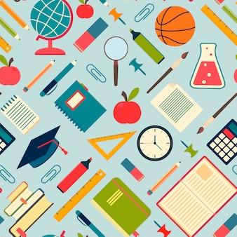 Herramientas y suministros escolares sobre un fondo azul