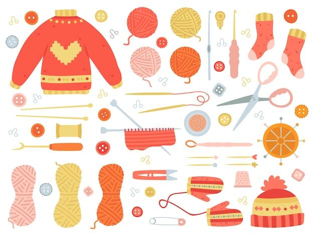Herramientas de tejer y ropa en diseño plano.