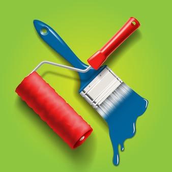 Herramientas de trabajo: brocha y rodillo con pintura de color rojo y azul