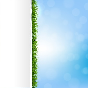 Hierba verde con papel rasgado
