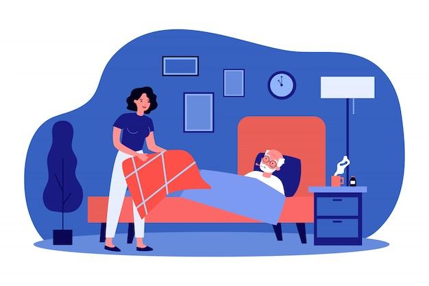 Hija cuidando de padre anciano enfermo