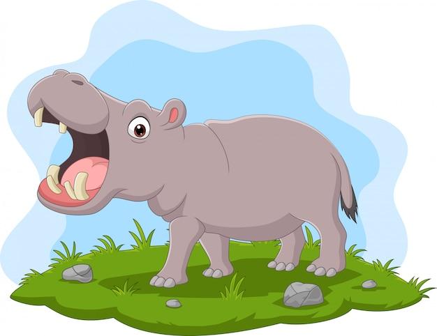 Hipopótamo de dibujos animados con la boca abierta en la hierba