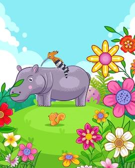 Hipopótamo lindo feliz con flores jugando en el jardín