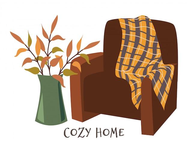 Hogar acogedor. sillón con cuadros y ramas en florero.