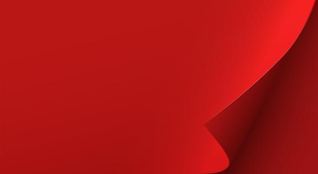 Hoja de papel rojo con esquina curvada