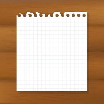 Hoja de papel sobre fondo de madera,