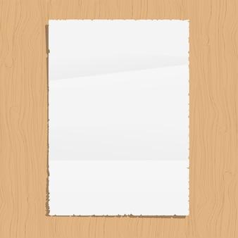 Hoja de papel vacía sobre fondo de madera
