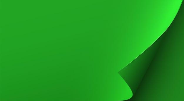 Hoja de papel verde con esquina curvada