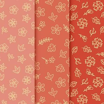 Hojas doradas sobre fondo rojo patrón de primavera dibujado a mano