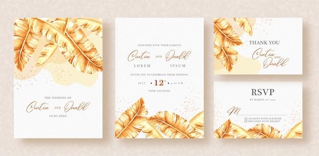 Hojas doradas tropicales en invitación de boda