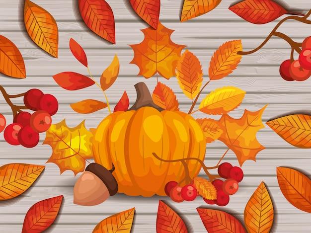 Hojas de otoño con calabaza y nuez sobre madera